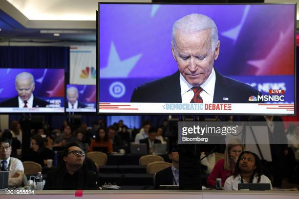 Former Vice President Joe Biden 2020 Democratic presidential candidate is seen on television screens during the Democratic presidential candidate...