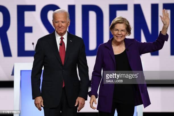 Former Vice President Joe Biden and Massachusetts Senator Elizabeth Warren arrive on stage for the fourth Democratic primary debate of the 2020...