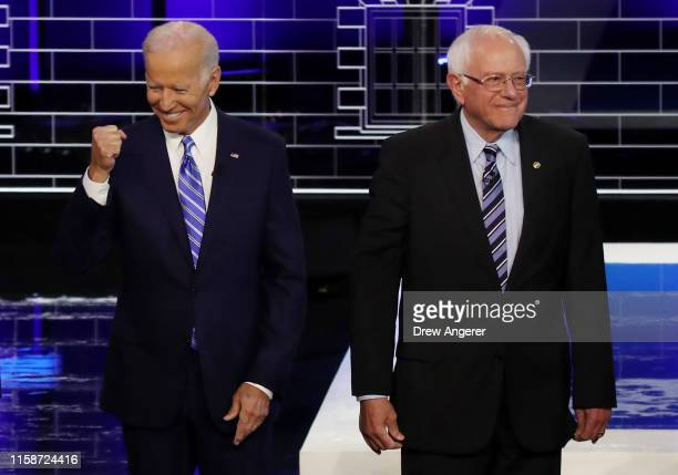 former Vice President Joe Biden and Sen Bernie Sanders take the stage for the second night of the first Democratic presidential debate on June 27...