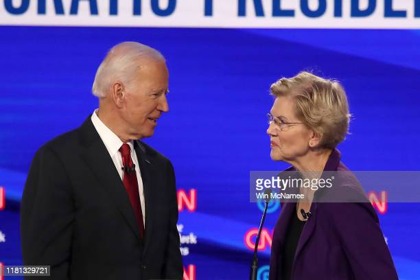 Former Vice President Joe Biden and Sen. Elizabeth Warren react during a break at the Democratic Presidential Debate at Otterbein University on...
