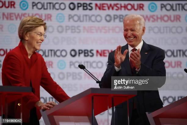 Former Vice President Joe Biden applauds Sen Elizabeth Warren during the Democratic presidential primary debate at Loyola Marymount University on...