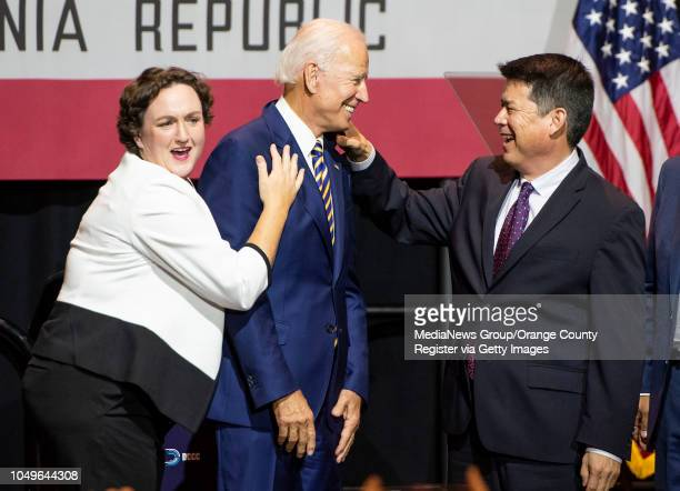 Former Vice President Joe Biden, center, shares a laugh with congressional candidates, Katie Porter, left, and TJ Cox, right, at the conclusion of...