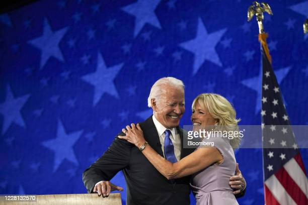 Former Vice President Joe Biden, Democratic presidential nominee, left, and wife Jill Biden smile during the Democratic National Convention at the...