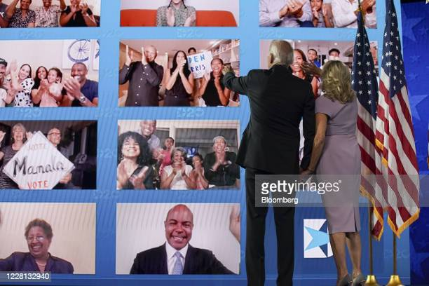 Former Vice President Joe Biden, Democratic presidential nominee, left, and wife Jill Biden look at viewers watching virtually during the Democratic...