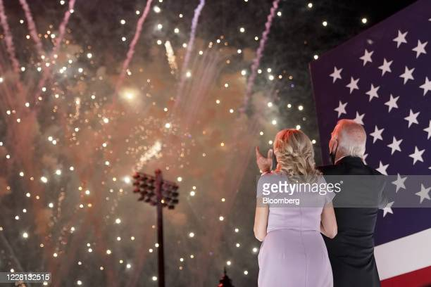 Former Vice President Joe Biden, Democratic presidential nominee, right, and wife Jill Biden watch fireworks outside the Chase Center during the...