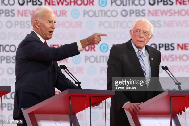 Former Vice President Joe Biden gestures as Sen Bernie Sanders listens during the Democratic presidential primary debate at Loyola Marymount...
