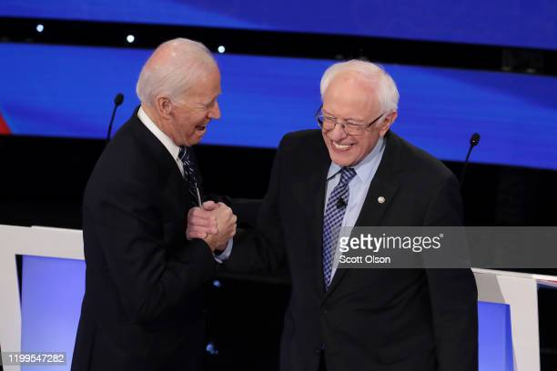 Former Vice President Joe Biden greets Sen Bernie Sanders before the Democratic presidential primary debate at Drake University on January 14 2020 in...
