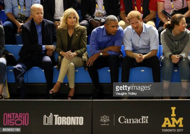 Former Vice President Joe Biden Jill Biden former US President Barack Obama and Prince Harry chat while watching the Wheelchair Basketball pool match...