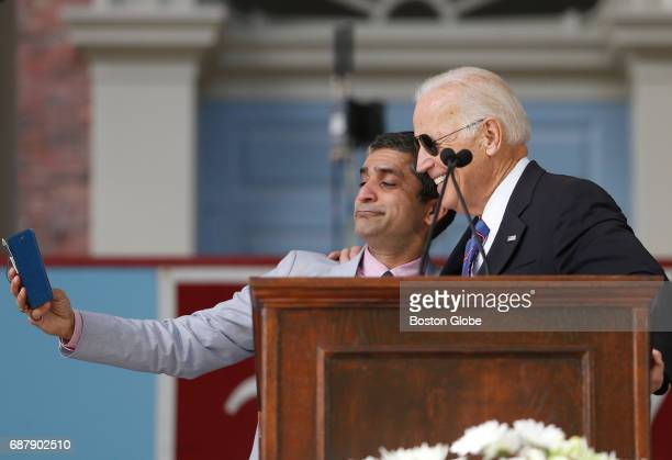 Former Vice President Joe Biden jokes with Dean of Harvard College Rakesh Khurana about making a meme together as he speaks during Class Day...