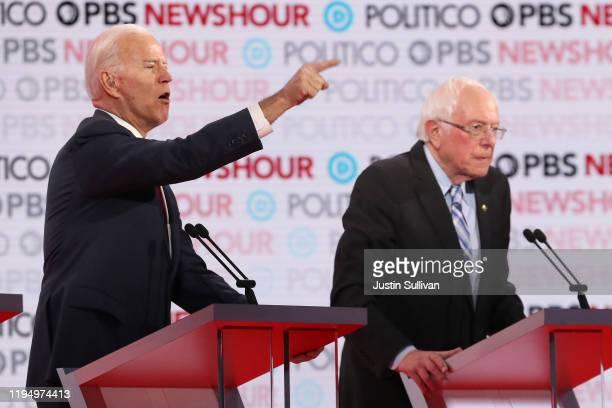 Former Vice President Joe Biden makes a point as Sen Bernie Sanders listens during the Democratic presidential primary debate at Loyola Marymount...
