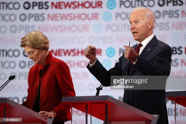Former Vice President Joe Biden makes a point as Sen Elizabeth Warren stands by during the Democratic presidential primary debate at Loyola Marymount...