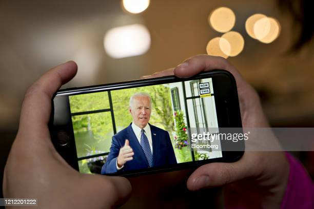 Former Vice President Joe Biden presumptive Democratic presidential nominee speaks during a NowThis economic address seen on a smartphone in...