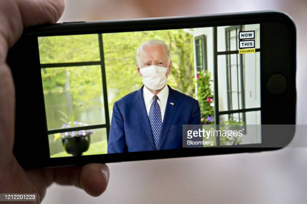Former Vice President Joe Biden presumptive Democratic presidential nominee wears a protective mask during a NowThis economic address seen on a...