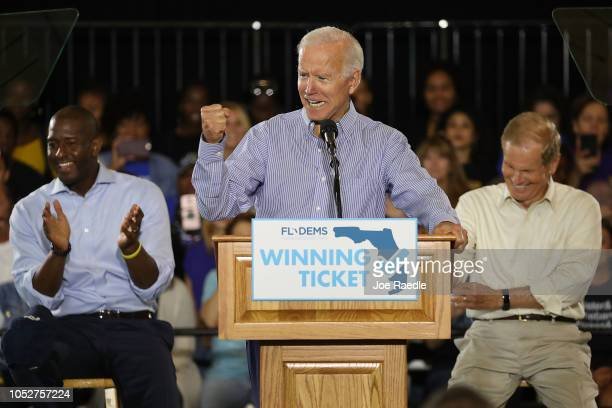 Former Vice President Joe Biden speaks as Florida Democratic gubernatorial nominee Andrew Gillum and US Sen Bill Nelson listen behind him during a...