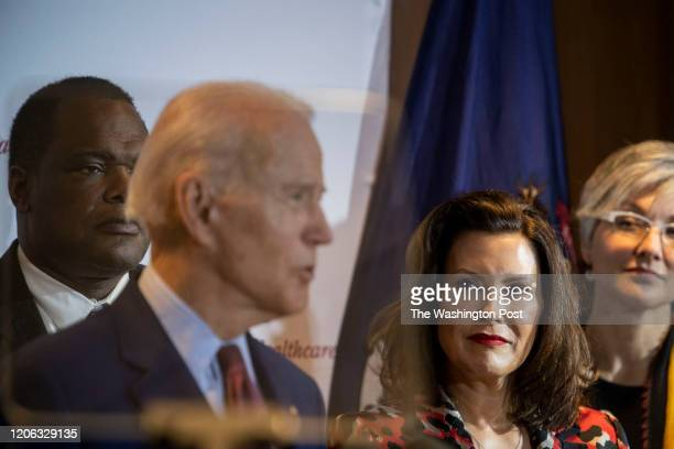 Former Vice President Joe Biden speaks as Michigan Governor Gretchen Whitmer looks on at an event at Cherry Health in Grand Rapids MI on March 9 2020