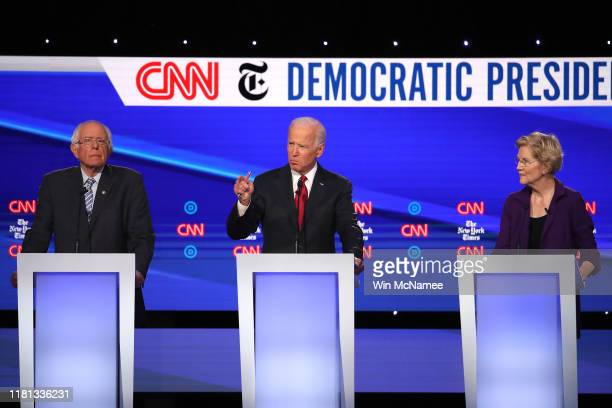 Former Vice President Joe Biden speaks as Sen Bernie Sanders and Sen Elizabeth Warren look on during the Democratic Presidential Debate at Otterbein...