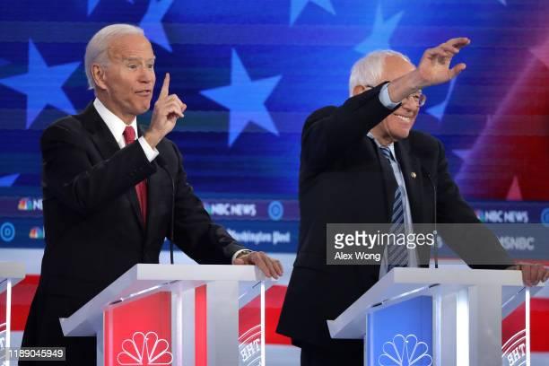 Former Vice President Joe Biden speaks as Sen Bernie Sanders gestures during the Democratic Presidential Debate at Tyler Perry Studios November 20...