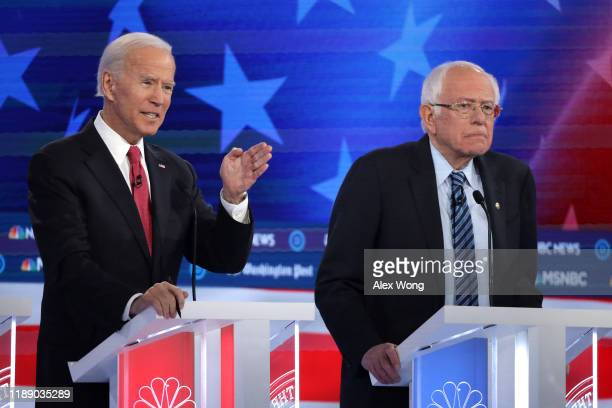 Former Vice President Joe Biden speaks as Sen Bernie Sanders listens during the Democratic Presidential Debate at Tyler Perry Studios November 20...