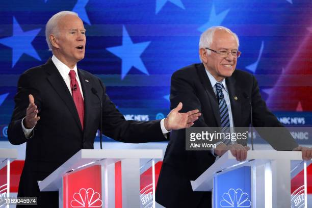 Former Vice President Joe Biden speaks as Sen Bernie Sanders smiles during the Democratic Presidential Debate at Tyler Perry Studios November 20 2019...