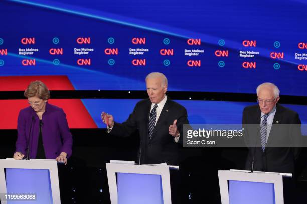 Former Vice President Joe Biden speaks as Sen. Elizabeth Warren and Sen. Bernie Sanders listen during the Democratic presidential primary debate at...