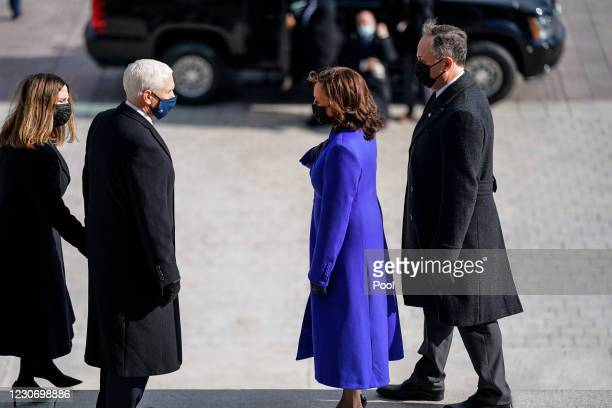 Former Vice President Mike Pence and his wife, Karen Pence speak with Vice President Kamala D. Harris and second gentleman Doug Emhoff, after the...