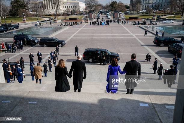 Former Vice President Mike Pence and his wife, Karen Pence walk down the steps of the U.S. Capitol with Vice President Kamala D. Harris and second...
