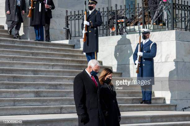 Former Vice President Mike Pence and his wife Karen Sue Pence, depart the US Capitol following the inauguration ceremony on the West Front of the...