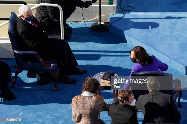 Former Vice President Mike Pence looks at Vice President Kamala Harris during the 59th presidential inauguration on the West Front of the U.S....
