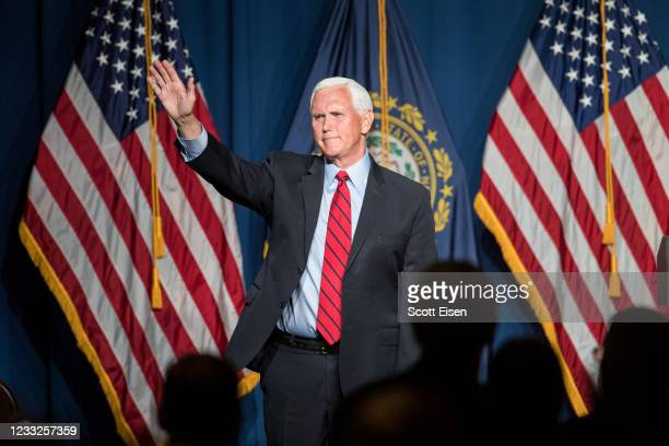 Former Vice President Mike Pence waves after addressing the GOP Lincoln-Reagan Dinner on June 3, 2021 in Manchester, New Hampshire. Pence's visit to...
