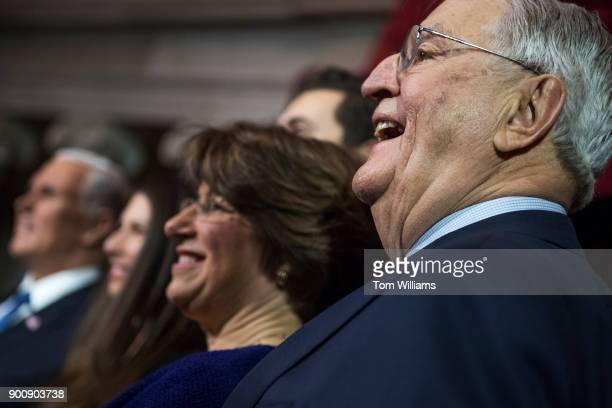 Former Vice President Walter Mondale is seen with Sen Amy Klobuchar DMinn and Vice President Mike Pence far left during a swearingin ceremony for Sen...