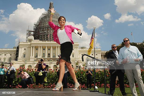 Former vice presidential candidate Sarah Palin takes the stage during a rally against the Iran nuclear deal on the West Lawn of the US Capitol...