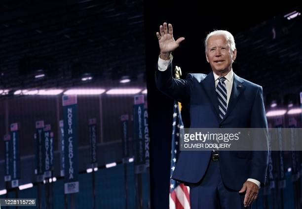 Former vice-president and Democratic presidential nominee Joe Biden waves on stage at the end of the third day of the Democratic National Convention,...