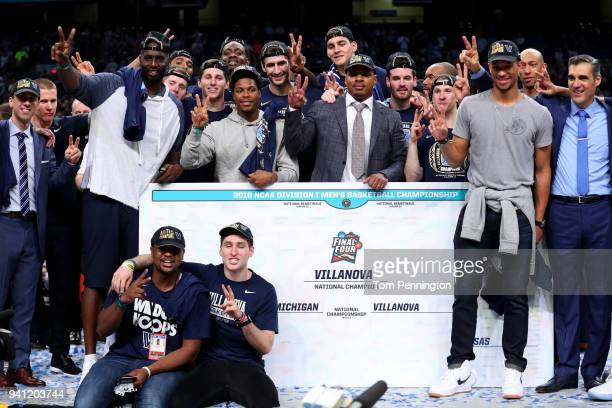 Former Villanova Wildcats Tim Thomas Kyle Lowry and Randy Foye celebrate with the team after defeating the Michigan Wolverines during the 2018 NCAA...