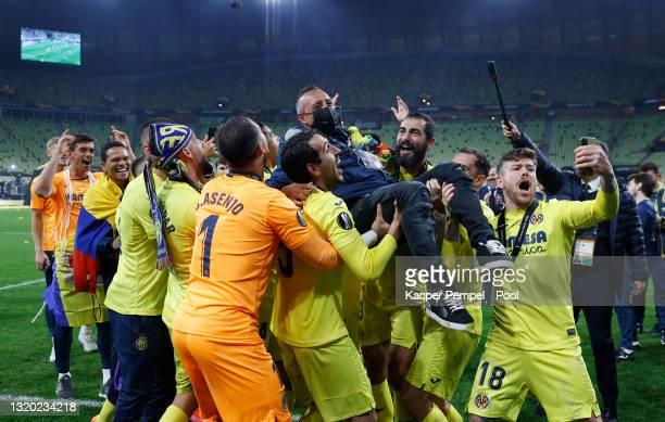 Former Villarreal CF Footballer Santi Cazorla is thrown into the air in celebration following the UEFA Europa League Final between Villarreal CF and...