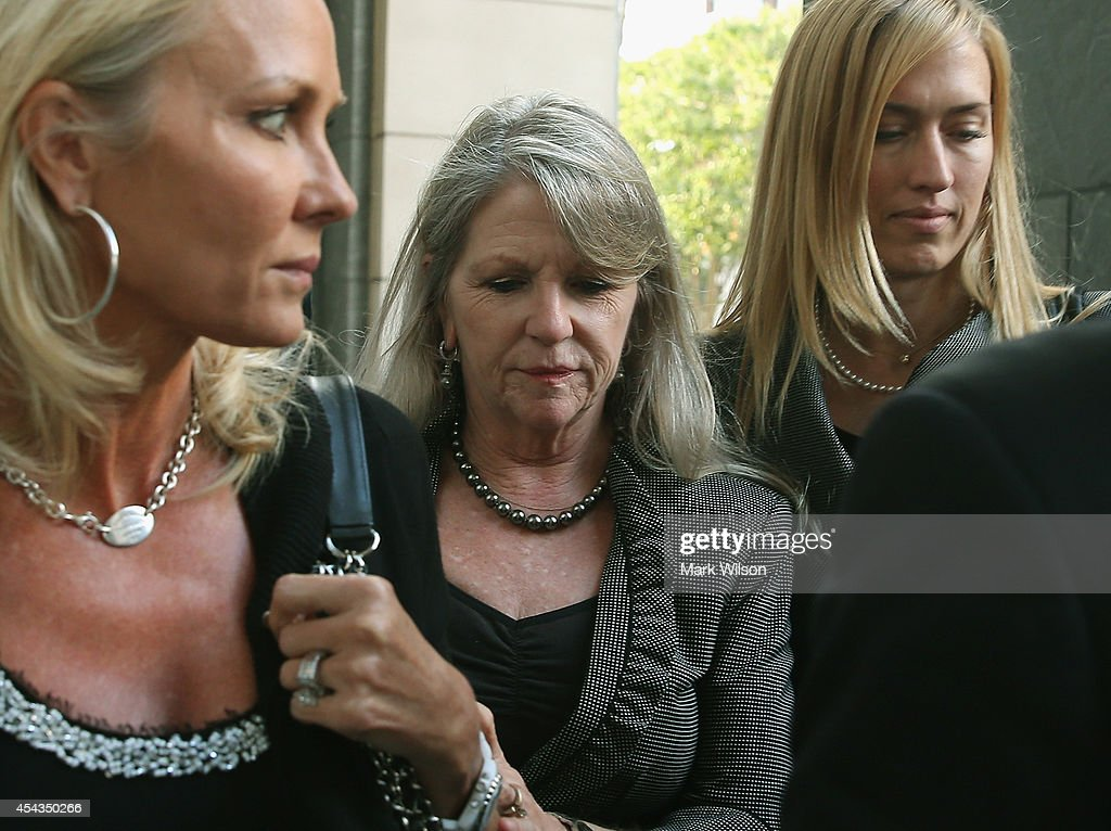 Former Virginia first lady Maureen McDonnell (C) leaves her trial at U.S. District Court house August 29, 2014 in Richmond, Virginia. McDonnell and her husband, former Virginia Governor Bob McDonnell, are on trial for accepting gifts, vacations and loans from a Virginia businessman in exchange for helping his company, Star Scientific