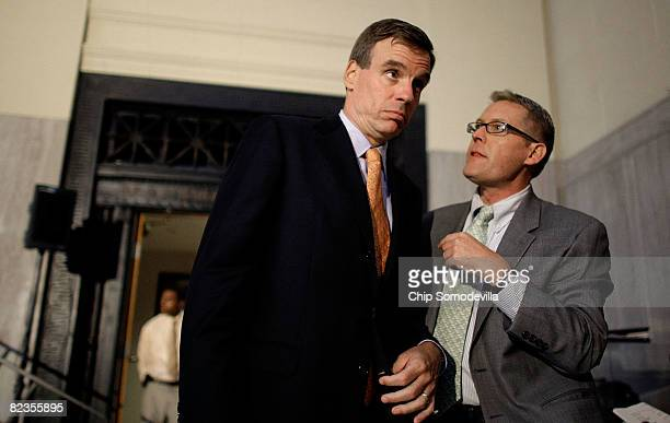 Former Virginia Gov and Democratic candidate for US Senate Mark Warner speaks with a staff member during a fundraising event at the Science Museum of...