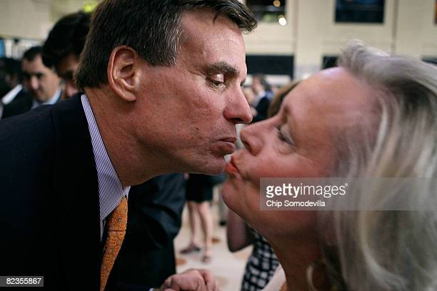 Former Virginia Gov and Democratic candidate for US Senate Mark Warner leans in for a kiss from a supporter during a fundraising event at the Science...