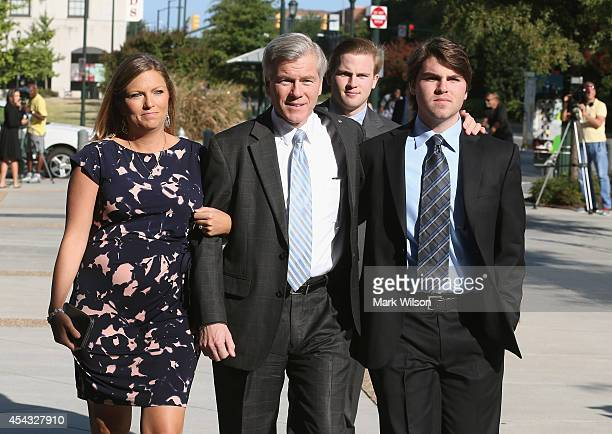 Former Virginia Governor Bob McDonnell arrives for his trial at US District Court with his daughter Jeanine and sons Bobby and Sean August 29 2014 in...