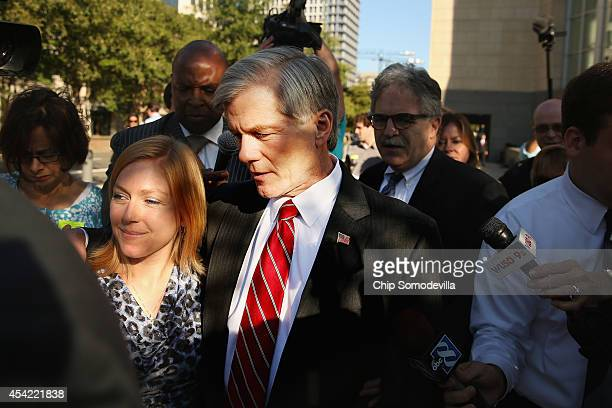 Former Virginia Governor Bob McDonnell is accompanied by his daughter Cailin Young as they are surrounded by his legal team and journalists after...
