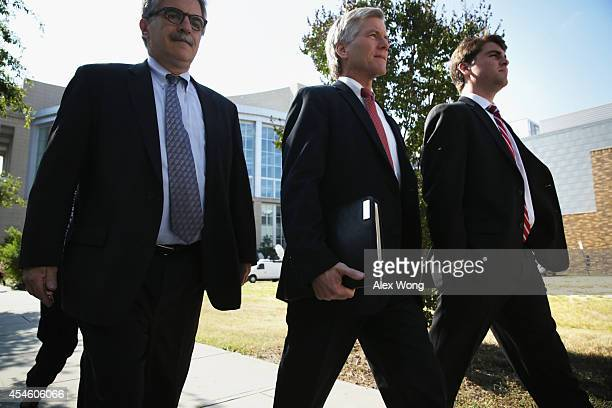 Former Virginia Governor Robert McDonnell leaves US District Court for the Eastern District of Virginia with his son Bobby on the third day of...