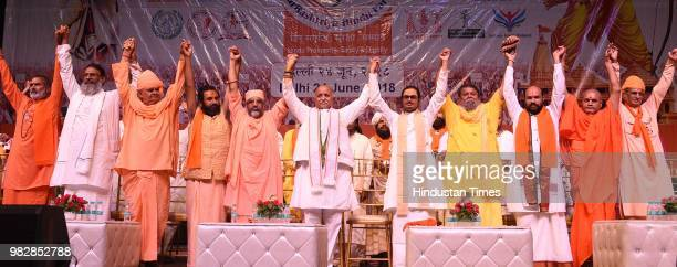Former Vishwa Hindu Parishad leader Pravin Togadia is presented a sword during the launch of his new outfit International Hindu Council at Siri Fort...