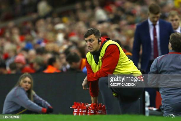 Former Wales captain, now assistant coach Sam Warburton waits on the touchline with drinks for players during the Six Nations international rugby...