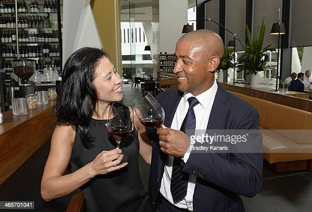 Former Wallabies captain George Gregan and wife Erica Gregan enjoy a glass of red wine at their cafe GG Espresso on January 29 2014 in Brisbane...