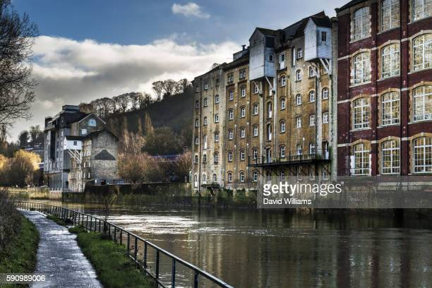 former warehouse and industrial buildings on the banks of the river avon in bath - bath england stock pictures, royalty-free photos & images