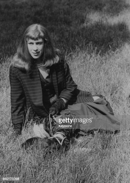 Former wartime fighter pilot Roberta Cowell with her dogs in Kensington Gardens, London, 21st June 1954. Born as Robert Cowell, she was the first...