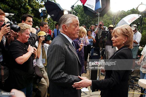 Former Washington Post editor Ben Bradlee and journalist Barbara Walters finish an interview outside the National Cathedral after the funeral of...