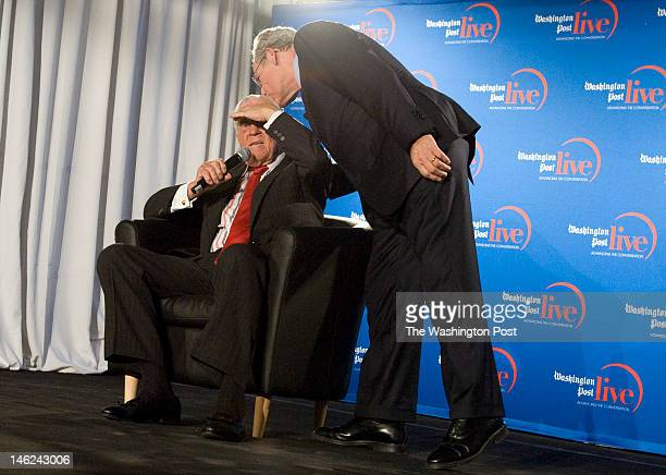 Former Washington Post executive editor Ben Bradlee is kissed on his head by his former reporter Bob Woodward during a tribute to the legendary...