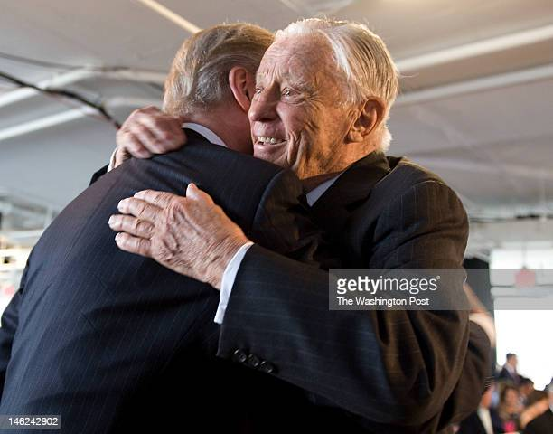 Former Washington Post executive editor Ben Bradlee right hugs William Cohen before a 40th anniversary Watergate event at The Watergate office...