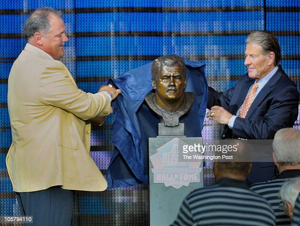 Former Washington Redskin and NFL Hall of Fame inductee Russ Grimm left and his former line coach Joe Bugel right unveil his bust during the...
