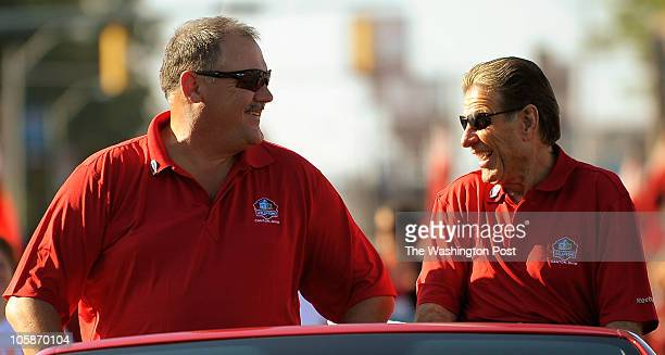 Former Washington Redskin and NFL Hall of Fame inductee Russ Grimm left and his former offensive line coach Joe Bugel right ride in the Grand Parade...